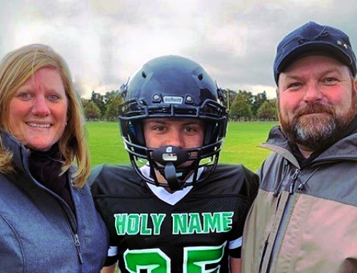 Troy, Tami & Isaac Sarles – Family from Marquette drawn to Holy Name